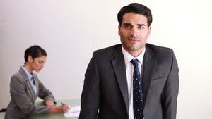 Businessman coming in an office
