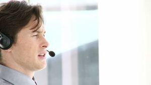 Charming businessman with headset