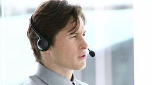 Charming businessman working in a call center