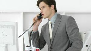 Young male executive talking on phone
