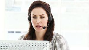 Positive businesswoman working in a call center