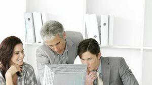 Positive business group working at a computer