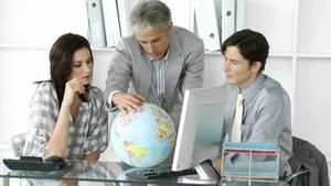 Fortunate business team looking at a terrestrial globe