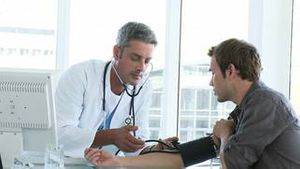 Male doctor examining a patient