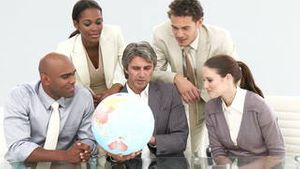 Multiethnic business team looking at a terrestrial globe