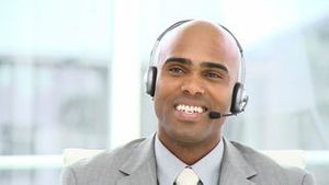 Charming businessman with headset on