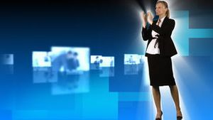 Blond woman presenting people at work