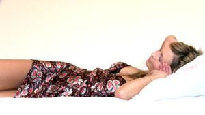 Sensual woman lying down on bed