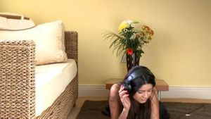 Positive woman lying down on the floor listening music