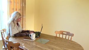 Quiet woman working at a laptop drinking coffee