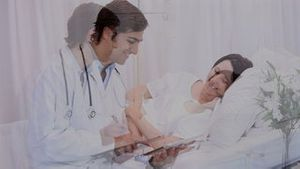 A doctor speaking to his patient