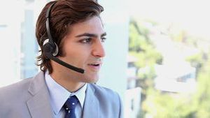 A businessman talking with a headset