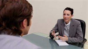 Young woman interviewing a man