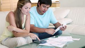 Young couple doing their accounts