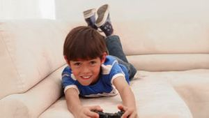 Boy playing videos games