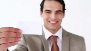 Smiling man holding a business card