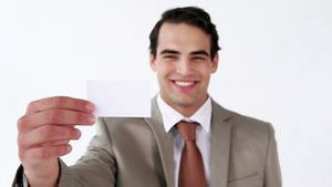 Serious man holding a business card