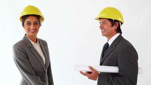 Smiling architects shaking their hands