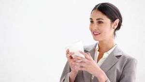 Businesswoman drinking from a cup