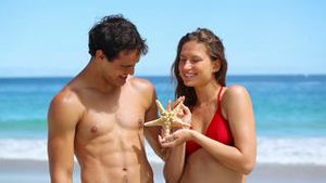 Smiling couple looking at a starfish