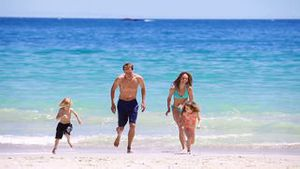 Smiling family running together