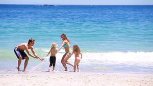 Cheerful family playing together