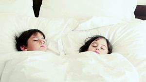 Peaceful children sleeping together