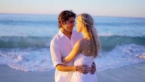 Couple kissing during sunset on the beach