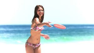 Brunette playing frisbee in slow motion