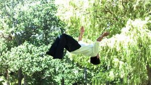Man performing a backflip in slow motion