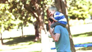 Father in slow motion holding his son
