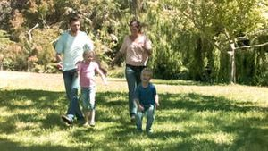 Family in slow motion running together