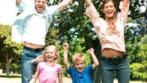 Family jumping together in slow motion