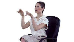 Businesswoman concentrating while using a virtual keyboard