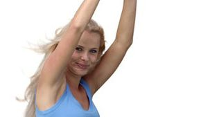 Blonde woman enthusiastically dancing