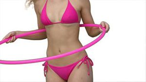 Woman trying to use a hula hoop