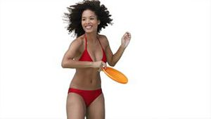 Woman in a red bikini playing Frisbee