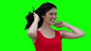Woman swaying while flicking her hair