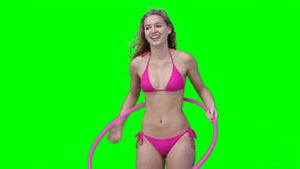 A woman playing with a hula hoop