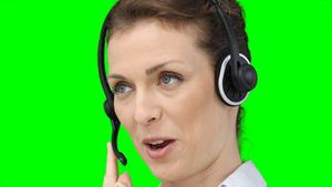Close up of a woman on a headset