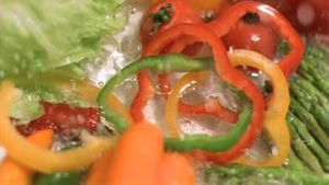 Water falling on vegetables in super slow motion