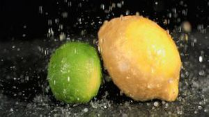 Water raining on fruit in super slow motion