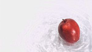 Apple turning in water in super slow motion