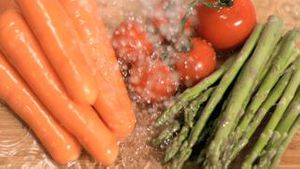 Water raining on vegetables in super slow motion