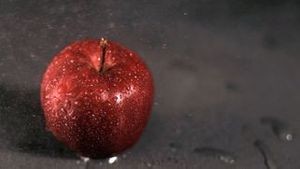 Water sprayed on apple in super slow motion
