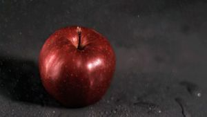 Water dripping on apple in super slow motion