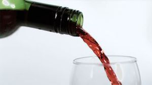 Red wine being poured in super slow motion