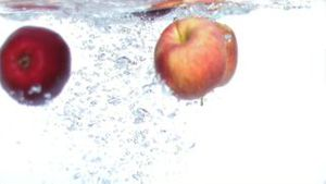 Apples falling into water in super slow motion