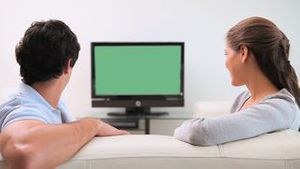 Couple looking at the television screen