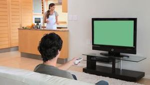 Man watching a movie on the television